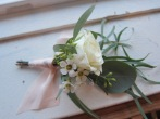Perfect winter wedding boutonniere made with eucalyptus, spray rose and waxflower   designed by Natasha Price of alaskaknitnat.com