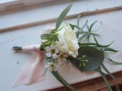 Perfect winter wedding boutonniere made with eucalyptus, spray rose and waxflower | designed by Natasha Price of alaskaknitnat.com